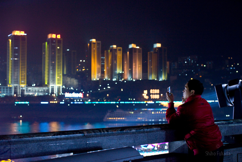 People enjoy their evening at Chaotianmen Square in Chongqing, China, March 2, 2009.
