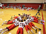 A group of Aplington-Parkersburg football players lay on the ground in a circle before their game at Turkey Valley High School in Jackson Junction, Iowa on October 3, 2008. (Stephen Mally / Special to The Denver Post)