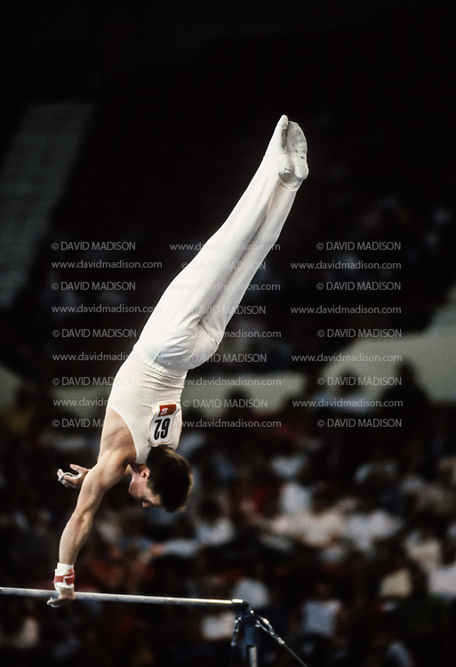 PHOENIX - APRIL 24:  Kevin Davis of the United States competes on the high bar during a USA - USSR gymnastics meet on April 24, 1988  at the Arizona Veterans Memorial Coliseum in Phoenix, Arizona.  (Photo by David Madison/Getty Images)