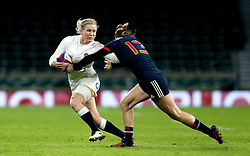 Danielle Waterman of England hands off Caroline Ladagnous of France Women - Mandatory by-line: Robbie Stephenson/JMP - 04/02/2017 - RUGBY - Twickenham - London, England - England v France - Women's Six Nations