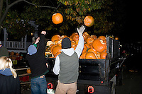 Keene State College students clean up Jack o Lanterns at the Keene Pumpkin Festival