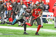 Tampa Bay Buccaneers Wide Receiver Mike Evans (13) fumbles under pressure from Carolina Panthers Defensive Back James Bradberry (24) during the International Series match between Tampa Bay Buccaneers and Carolina Panthers at Tottenham Hotspur Stadium, London, United Kingdom on 13 October 2019.