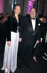 The HON.NICHOLAS SOAMES and his wife SERENA at the Conservative Party's Black & White Ball held at Old Billingsgate, 16 Lower Thames Street, London EC3 on 8th February 2006.<br />