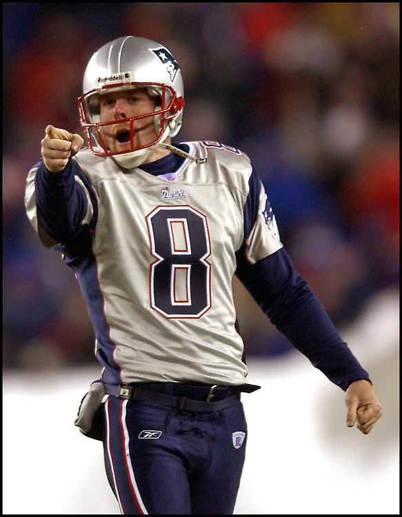(12/7/03Foxboro, MA) New England Patriots vs Miami Dolphins. Patriots Punter Brooks Bernard celebrates and points to where his second punt inside the 10 yard line landed in the 2nd half. (120703patsmjs-staff photo by Michael Seamans. Saved in photo Monday/cd)