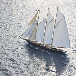 The 2010 Sailing yacht Atlantic is magnificent replica of the 1903 William Gardner designed three-masted sailing schooner Atlantic, owned by Ed Kastelein. The 1903 sailing schooner was a long time World record holder for the crossing of the Atlantic Ocean under sail in 1905 winning the KaiserÕs Cup from New York to The Lizard. The record held firm for almost a century, when it was broken in 1998. It is the longest standing speed record in the Yachting History. .The Owner, Ed Kastelein is the man responsible for the recreation of this wonderful new schooner Atlantic, and is also behind such projects as the sailing yacht Thendara, sailing yacht Aile Blanche, sailing yacht Borkumriff, sailing yacht Zaca a te Moana and most recently the Herreshoff racing schooner Eleonora E...The Dutch Van der Graaf yard first launched the Sailing Yacht Atlantic in 2008. Following her launch, she underwent an extensive programme of fitting out. 2009 saw the assembly of her three masts, with a height of 45 metres, supporting 1700m? of sails. Her raven black high gloss hull reflects the ripples of the water and one glance at the three towering masts, instantly give the sense of power that this mighty yacht Atlantic has...Sailing schooner Atlantic is the largest classic sailing schooner ever created, measuring 185 feet (56 metres) over deck and with the bowsprit to boom length of 227 feet (69 metres). Her graceful sheerline and long overhangs accentuate her grace while her waterline length of 42 meters and narrow beam are a promise for unmatched speed under sail...On June 23rd 2010, sailing schooner Atlantic sailed out to sea, three years after her keel was laid. The Owner, Ed Kastelein, saw his long term dream come true, as he witnesses his family, guest and crew step on board of Atlantic yacht. Her maiden voyage was a two month leisurely cruise from Rotterdam to Cannes and she exceeded all expectations, sailing fast at every point of sail with amazing ease and comfort.Yacht Charter Acco