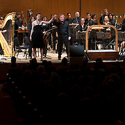 """June 8, 2012 - New York, NY : Conductor David Robertson, standing at center right, takes the hand of soprano Charlotte Dobbs, standing at center left, as they and the New York Philharmonic take a bow after performing the U.S. premiere of Michael Jarrell's 'NACHLESE Vb: Liederzyklus' (2011) during The Metropolitan Museum of Art's Presentation of """"CONTACT!,"""" the new-music series of the New York Philharmonic, on Friday night. CREDIT: Karsten Moran for The New York Times"""