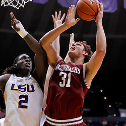February 4, 2012; Baton Rouge, LA; Arkansas Razorbacks forward Michael Sanchez (31) shoots over LSU Tigers forward Johnny O'Bryant (2) during the second half of a game at the Pete Maravich Assembly Center. LSU defeated Arkansas 71-65.  Mandatory Credit: Derick E. Hingle-US PRESSWIRE