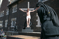 ©Licence to London News Pictures. 25/0 3/2016. The annual Good Friday service in Croydon with a reinactment of the Crucifixion of Jesus in the Northend of Croydons shopping centre. Also the choir of The Croydon Minster. Photo credit: Presspics/LNP