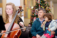 Centerville High School Orchestra member Margaret Otto (left) performs holiday music at the WashingtonCenterville Public Library in Centerville, Monday, December 5, 2011.