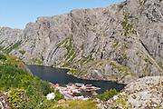 Red rorbus (fishermen's shanties for tourist holiday rentals) Nusfjord village, Lofoten archipelago, Nordland county, Norway.