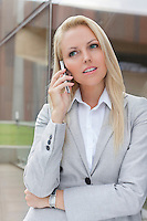 Blonde businesswoman communicating on cell phone