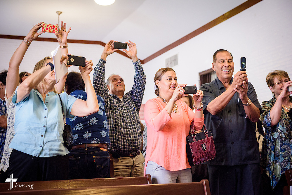 Parishioners and guests photograph the group of clergy following the installation service for the Rev. Dr. Antonio Lopez, new national missionary pastor at El Calvario Lutheran Church on Sunday, July 31, 2016, in Brownsville, Texas. LCMS Communications/Erik M. Lunsford
