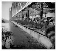 Traffic crossing the Howrah Bridge, Calcutta.