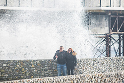 Brighton, UK. 21/11/2016, Members of the public get soaked as powerful waves are hitting the pontoon next to the Brighton Palace Pier. Photo Credit: Hugo Michiels