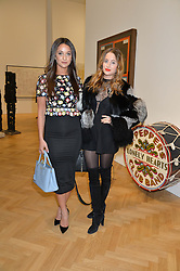 Left to right, ROXIE NAFOUSI and ROSIE FORTESCUE at the opening private view of 'A Strong Sweet Smell of Incense - A portrait of Robert Fraser, held at the Pace Gallery, Burlington Gardens, London on 5th February 2015.