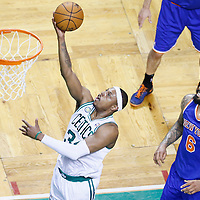 26 April 2013: Boston Celtics small forward Paul Pierce (34) goes for the layup past New York Knicks center Tyson Chandler (6) during Game Three of the Eastern Conference Quarterfinals of the 2013 NBA Playoffs at the TD Garden, Boston, Massachusetts, USA.