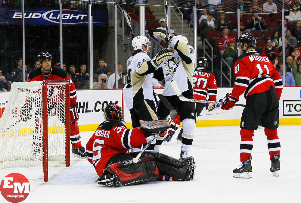 Dec 10, 2008; Newark, NJ, USA; Pittsburgh Penguins left wing Matt Cooke (24) celebrates his goal during the third period at the Prudential Center. The Devils defeated the Penguins 4-1.