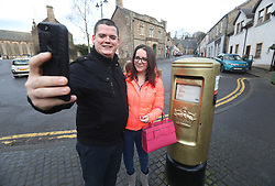 Callum Innes and Caroline Brown take a selfie with the gold post box in Andy Murray's home town of Dunblane, he has said he is aiming to end his career after Wimbledon but the Australian Open may be his last tournament.