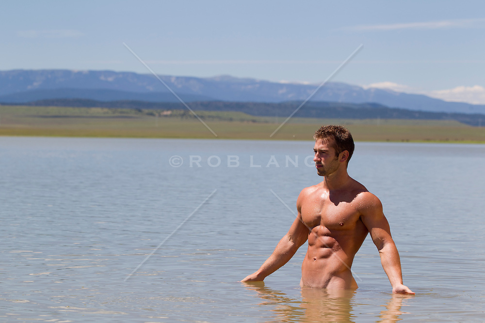 naked man standing in a lake in New Mexico