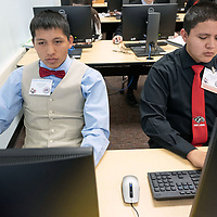 Tohatchi High School students Justin Leonard, 15, left, and Christian Miller, 17, right enter their student codes to begin their testing in the Business Professionals of America testing held in Albuquerque Feb. 14, 2019.