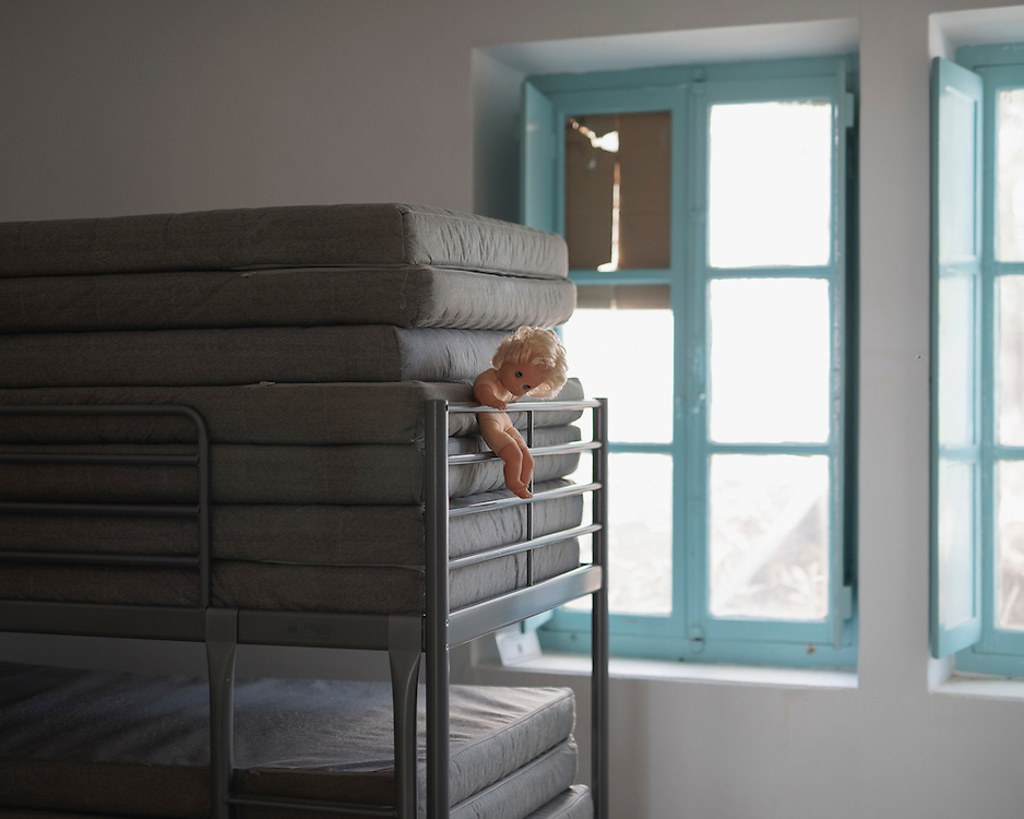 An abandoned child's doll on a bunkbed in Villa Artemis, a shelter for 30 refugee women and their children in the grounds of Leros Hospital. <br />