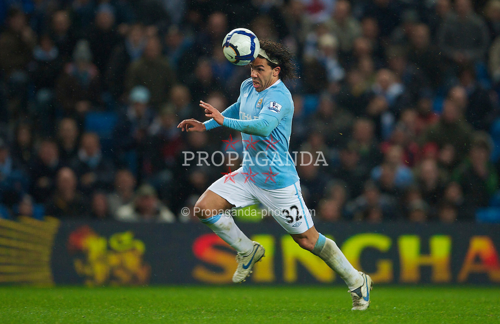 WIGAN, ENGLAND - Monday, March 29, 2010: Manchester City's hat-trick hero Carlos Tevez in action against Wigan Athletic during the Premiership match at the City of Manchester Stadium. (Photo by David Rawcliffe/Propaganda)