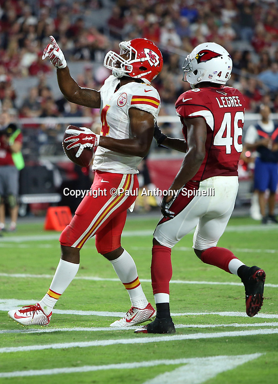 Kansas City Chiefs rookie wide receiver Da'Ron Brown (4) points and celebrates after catching a third quarter touchdown pass that gives the Chiefs a 24-10 lead while covered by Arizona Cardinals defensive back Jimmy Legree (46) during the 2015 NFL preseason football game against the Arizona Cardinals on Saturday, Aug. 15, 2015 in Glendale, Ariz. The Chiefs won the game 34-19. (©Paul Anthony Spinelli)