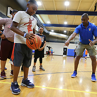 Ayden Edwards, 11, from Tupelo, gets instruction on his footing and his shot from Coach Stan Jefferson, a Tupelo High School Assistant Basketball Coach, during shooting drills at Basketball Camp at the Tupelo Police Athletic League on Thursday morning. The camp, which ends Friday, focuses on the fundamentals of the game. The age group for this weeks camp was 10-14. A camp will be held next month, July 9-13, for ages 14 and up at no charge on a first come first serve basis until all 40 spots are filled.