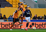 Dave Edwards battles with Lee Martin during the Sky Bet Championship match between Wolverhampton Wanderers and Millwall at Molineux, Wolverhampton, England on 2 May 2015. Photo by Alan Franklin.