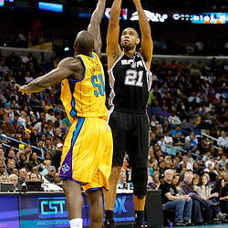 January 22, 2011; New Orleans, LA, USA; San Antonio Spurs center Tim Duncan (21) shoots over New Orleans Hornets center Emeka Okafor (50) during the third quarter at the New Orleans Arena. The Hornets defeated the Spurs 96-72.  Mandatory Credit: Derick E. Hingle
