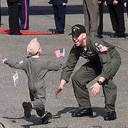 Lt. Patrick C. Honeck greets son after the 24 crew members of an American surveillance plane collided with a Chinese jet fighter and were capture arrives at NAS Whidbey Island, Washington after their release.