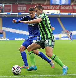 Alex Revell of Cardiff City is kept away from the ball by Jonathan Meades of AFC Wimbledon - Mandatory by-line: Paul Knight/JMP - Mobile: 07966 386802 - 11/08/2015 -  FOOTBALL - Cardiff City Stadium - Cardiff, Wales -  Cardiff City v AFC Wimbledon - Capital One Cup