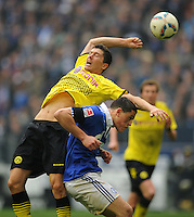 FUSSBALL   1. BUNDESLIGA   SAISON 2011/2012   31. SPIELTAG FC Schalke 04 - Borussia Dortmund                      14.04.2012 Robert Lewandowski (li, Borussia Dortmund) gegen Kyriakos Papadopoulos (re, FC Schalke 04)  xxNOxMODELxRELEASExx