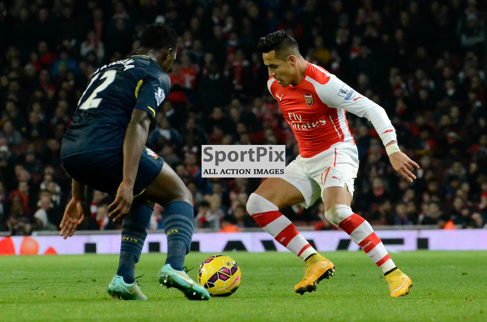 Arsenals Alexis Sanchez and Southamptons Victor Wanyama in action
