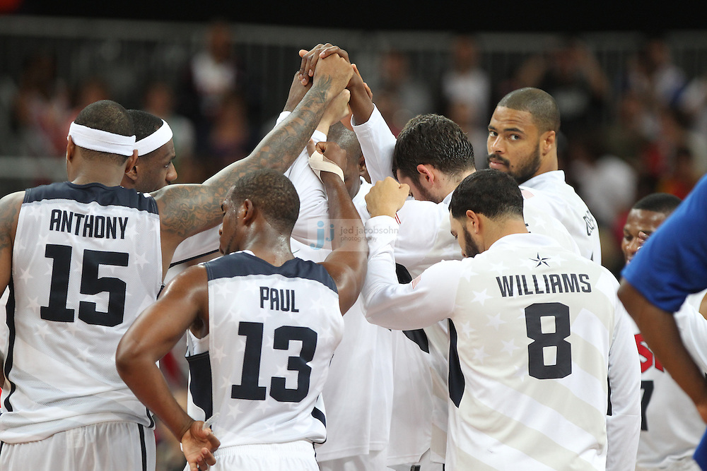 Members of the USA basketball team look on against France during Day 2 of the London Olympic Games in London, England, United Kingdom on 29 Jul 2012..(Jed Jacobsohn/for The New York Times)....