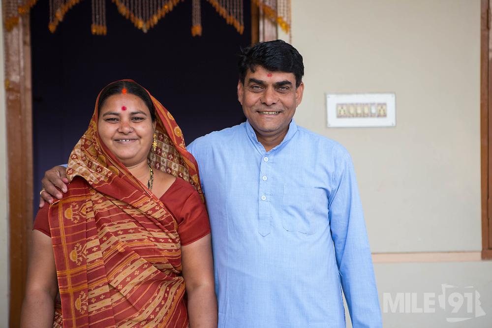 Shantilal and Maya outside their home, Madhya Pradesh, India.