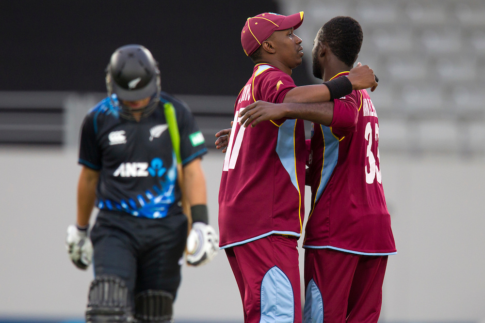 West Indies' captain Dwayne Bravo and Nikita Miller celebrate the wicket of  New Zealand's Ross Taylor in the Twenty-20 International Cricket Match, Eden Park, Auckland, New Zealand, Saturday, January 11, 2014. Credit: SNPA/David Rowland