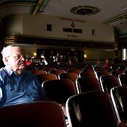Frank Dougherty, a former writer for the Philadelphia Daily News, sits in the auditorium of North Catholic High School where he spent every morning for four years. The school held its last services before being closing down due to budget cuts. (© Philadelphia Daily News)