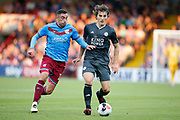 Calgary Soyuncu of Leicester City holds off Lee Novak Of Scunthorpe Unitedduring the Pre-Season Friendly match between Scunthorpe United and Leicester City at Glanford Park, Scunthorpe, England on 16 July 2019.