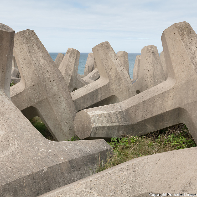 Concrete Dolosse (interlocking sea defence units) near Colwyn Bay, Conwy.