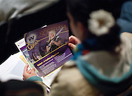 A prospective student looks through a packet of materials during an open house at Waldorf College in Forest City, Iowa on Saturday, May 14, 2011.
