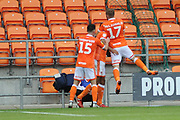 Blackpool Midfielder, Jordan Thompson (15) and Blackpool Defender, Ryan McLaughlin (17) help Blackpool Defender, Curtis Tilt (16) golal scorer celebrate during the EFL Sky Bet League 1 match between Blackpool and Bradford City at Bloomfield Road, Blackpool, England on 8 September 2018.