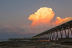 Stunning wet season clouds build up behind the Broome jetty.