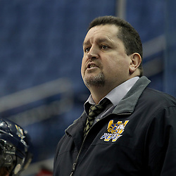 Buffalo, NY - Feb 20 : Ontario Junior Hockey League game action between the Buffalo Junior Sabres and the Whitby Fury, Whitby Fury head coach Craig Fisher talks to his team during a game against the Buffalo Junior Sabres Hockey Club. (Photo By Timothy T. Ludwig / OHJL Images)