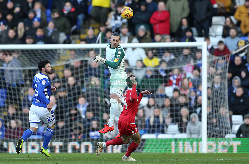 Birmingham City's keeper Lee Camp (centre) makes a clearance with his head against Nottingham Forest during the match at St Andrew's Trillion Trophy Stadium