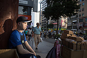 Kieu Van Dao sells cookies in downtown Taipei to make extra money for his living costs. <br />