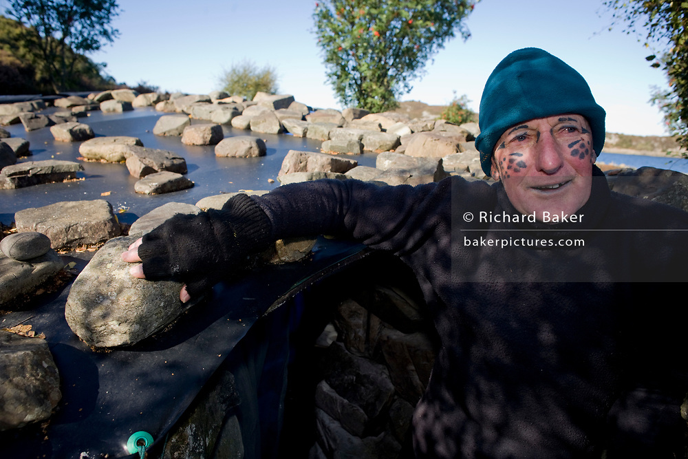 The tattooed hermit, Tom Leppard (1935-2016) at his secret island hideaway on the Isle of Skye, Scotland in 2007. <br /> <br /> (See main gallery caption).
