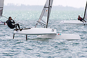 Blair Tuke (NZL265) rounds the top mark in race three of the A Class World championships regatta being sailed at Takapuna in Auckland. 12/2/2014
