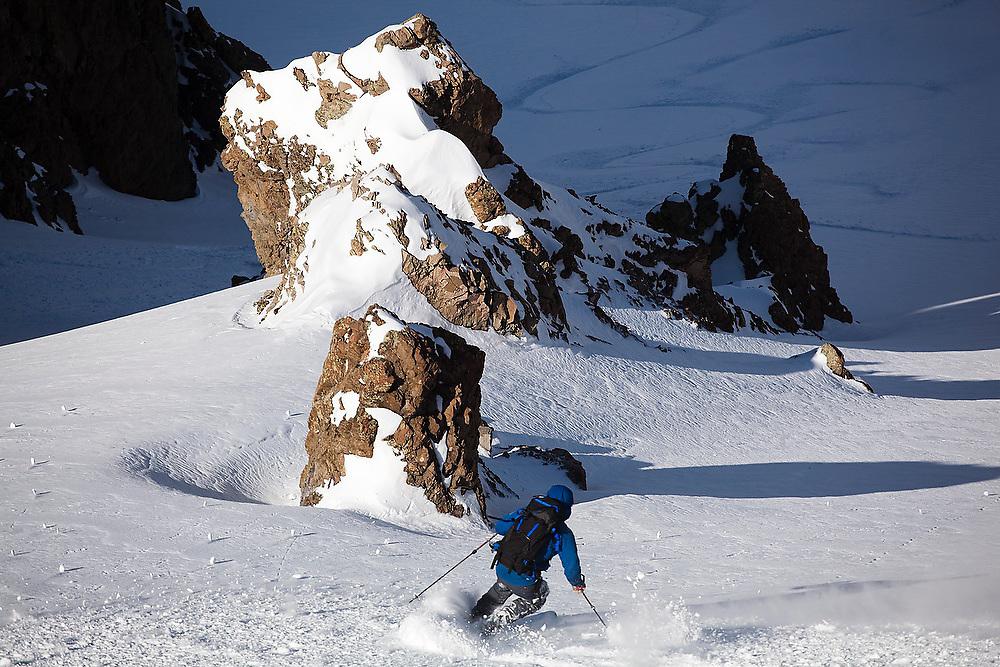 Backcountry skier Sterling Roop drops into a steep couloir below the summit of Hayden Peak, San Juan Mountains, Colorado.