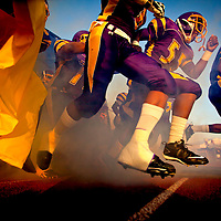 (08.26.2011)(PHOTO / CHIP LITHERLAND) -- Booker High School football players run onto the field against Braden River High School during the matchup at Booker High School in Sarasota, Fla., on Friday, August 26, 2011. (Photo by Chip Litherland)